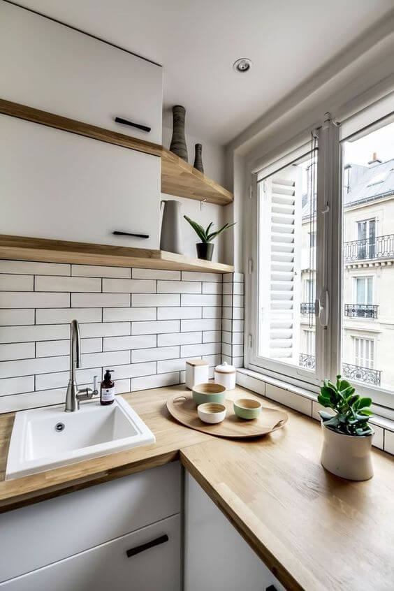 small kitchen decor ideas - 16. White Oak Village Apartment Kitchen - Harptimes.com