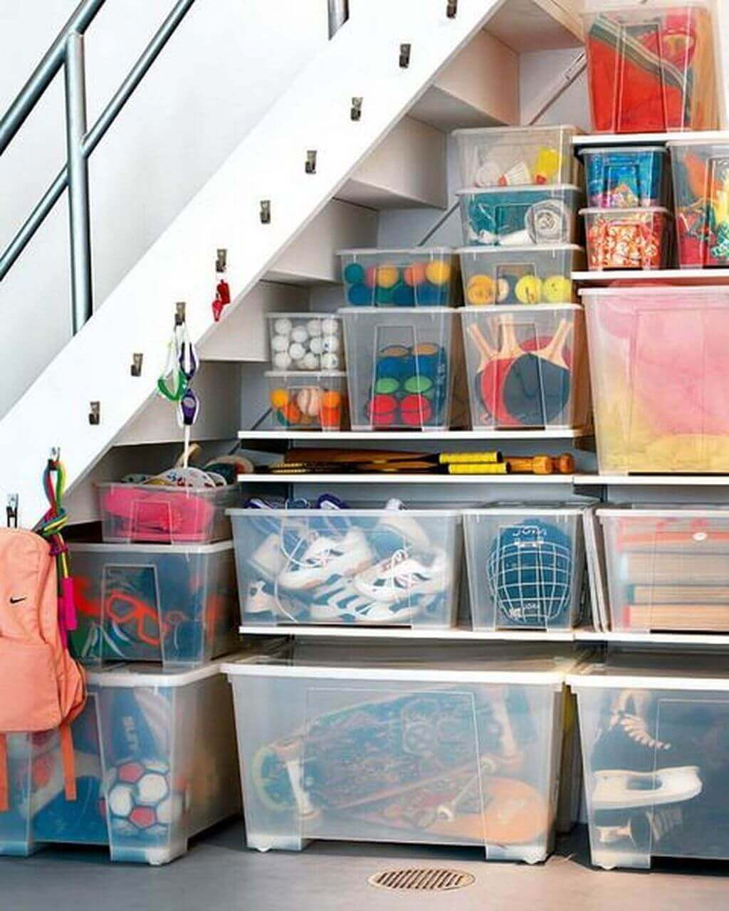 Simple Basement Storage Ideas under Stair Storage with Plastic Containers and Hangers