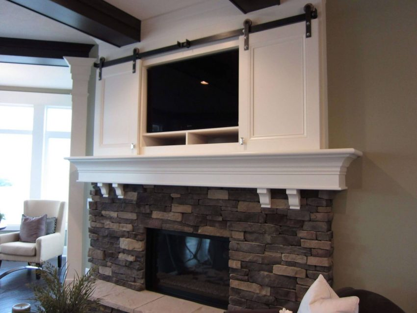 Beach House-Style Rustic Corner Fireplace with TV Above Ideas